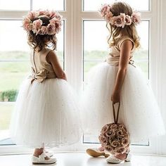 Adorable flower girls with their sparkly skirts and floral crowns ready for duty. Love!