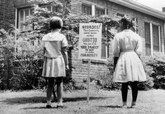 "depressing. ""An African American and a white girl study a sign in the integrated Long Island community of Lakeview, New York, on April 1962. The sign was an attempt to keep African Americans from exceeding the number of whites who want to live in an integrated town."""