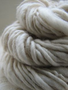 would make a great chunky knitted scarf!! and my favorite color grey!!