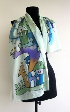 Hand painted silk scarf in green , blue , violet and orange colors with cartoon fantasy houses design .Comic paint by hand shawl . Long scarf ,