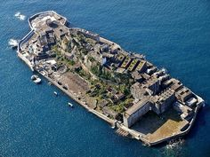 Above: Hashima Island, also known as Battleship Island, Japan.  Read more: https://sputniknews.com/photo/201601161033235701-world-abandoned-places-photos/