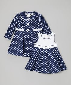 Swingy, sophisticated and sweet, this matching dress and coat bring polka-dot dazzle to a little lady's look. A zipper down the back of the dress makes it easy to slip on and off, while the coat buttons at the neck to create an elegant silhouette.