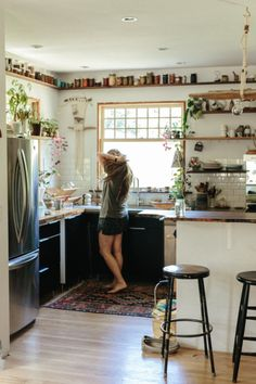Emily Katz // michaeljspear.  I love the plants and jars along the shelf.