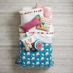 Shop Modern Mosaic Kids Bedding.  Look closely at our Modern Mosaic Kids Bedding, and you'll notice a festival of gorgeous, multi color embroidery and delicate tassel details.