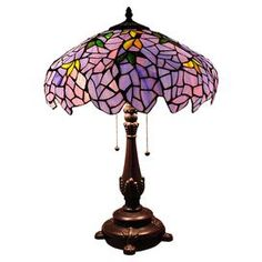 """Highlighted by hand-cut pieces of stained glass, this Tiffany-style table lamp adds Art Nouveau elegance to your bedroom or study.  Product: Table lampConstruction Material: Copper foiled glass and resinColor: MultiFeatures:  Pull chain switch424 Glass piecesUL approved Accommodates: (2) 60 Watt medium bulbs - not includedDimensions: 34"""" H x 16"""" Diameter"""