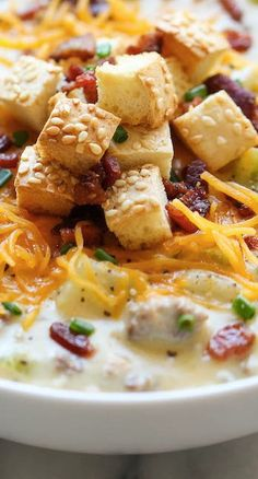 Cheeseburger Soup...the flavors of a cheeseburger in a creamy, comforting soup, topped with crisp bacon and hamburger bun croutons!