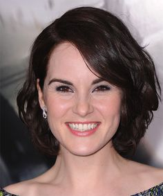 Michelle Dockery Hairstyle - Medium Wavy - Dark Brunette. Click on the image to try on this hairstyle and view styling steps!