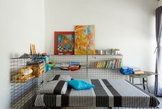 Metal-grid shelving bring the industrial vibe to the boys' bedroom. The lady of…