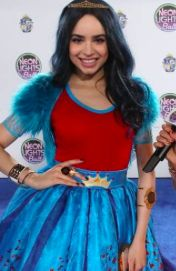 Sofia Carson as Evie the neon lights party