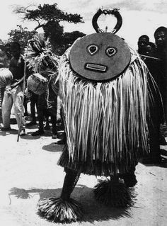 Africa | An old photograph by Hugo Zemp, from the Baule people. This shows an image of the 'Goli' dance and with a Kple-Kple masquerader. | Date unknown.