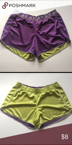 Adidas reversible mesh shorts Adidas mesh shorts, reversible from purple to lime green. Adidas logo waistband. In great condition, the logo has just peeled off but is not very noticeable at all. Smoke free home! Adidas Shorts