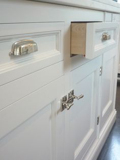Kitchen Cabinets With Knobs cabinet hardware: cup pulls on the drawers is a must! | home is