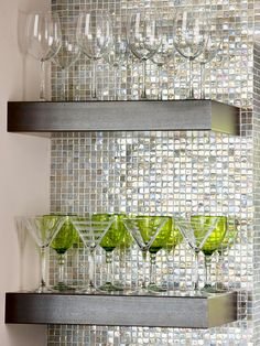 "Have a tiny bite of unused wall? BHG suggests turning the space into ""Newfound Storage"". Floating shelves installed on a wall of metallic mosaics creates a beautiful display area for stem or glassware. In a small space, you want to make sure that you don't overwhelm your ""little bite"" of wall with big bulky items. Keep the items as ""see-through"" as possible to eliminate visual clutter."