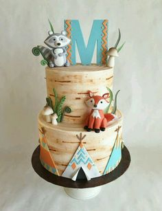 Tee pee cake.  But instead of Two layers. Just do a one layer 10 inch cake with the initial and fix on top