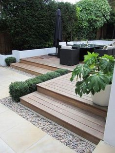 Deck steps and pebbles. No furniture but a pool!!!