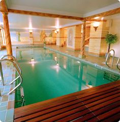 A Collection of Incredible Indoor Pool Designs : Elegant Rectangular Indoor Pool Design with Double Staircases