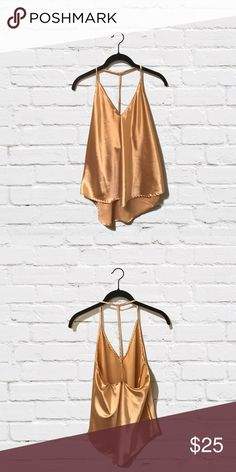 DESTINY // Champagne Satin Cami Very limited quantities! Gorgeous top with unique strappy halter design. This luxurious satin cami tank top is a beautiful shade of golden champagne. Super trendy and elegant. Available in my closet in silver as well. PRICE IS FIRM. NO TRADES. ✨ 88 Apparel Tops Blouses