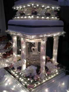 Tacky as hell, but awesome lit wedding cake stands - This one has a little water feature in the middle