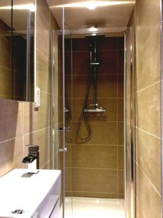 the en suite shower room is fully tiled in dark cream porcelain and features au2026