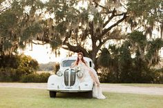 Tenille Houston's Boone Hall Plantation Bridals in Charleston, SC by Judy Nunez Photography with a 1938 Plymouth Deluxe from Lowcountry Valet & Shuttle and wearing an Inbal Dror wedding gown #lowcountry #charleston