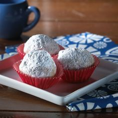 Cinnamon Snowballs -- 1 3/4 cups all-purpose flour 1 teaspoon cinnamon 3/4 cup Kellogg's® Corn Flake Crumbs 1 cup butter or margarine, softened 1/3 cup granulated sugar 2 teaspoons vanilla 1 cup finely chopped nuts Sifted powdered sugar