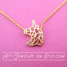 A super pretty animal themed necklace made with a pendant in the shape of the outline of a unicorns head in gold! Simple and pretty! Also available in silver in my store!