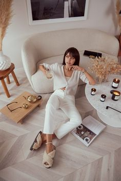 Chilling at home - wearing cozy faux fur slides (perfect for indoor and outside!), white high waisted jeans, and cardigan set from Naked Cashmere #outfit #home #outfitidea #cozy #slides #slippers #fauxfur #whitejeans #cashmere #cardiganset