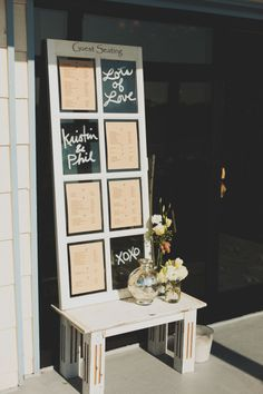 seating chart in an old window pane via stylemepretty.com