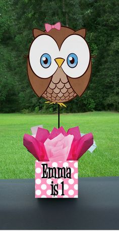 Owl Centerpiece by PrestigePartyPlanner on Etsy, $35.00....or just make it yourself, duh! sqaure styrofoam wrapped like a present, insert owl on a stick and hot glue tissue paper flowers.. easy peasy! -E