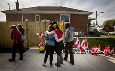 Workers from the St. Eugene Catholic Elementary School, where Cpl. Nathan Cirillo's son is enrolled, pay respects at a makeshift memorial outside the Cirillo family home in Hamilton, October 24, 2014.  REUTERS-Mark Blinch