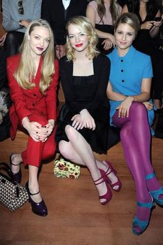 Sitting pretty in the front row: Amanda Seyfried, Emma Stone, and Dianna Agron at Miu Miu, Spring 2013