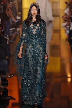 The Prettiest Dresses, Basically, Ever #refinery29  http://www.refinery29.com/2015/07/90464/couture-fashion-week-2015-fairytale-dresses#slide-17  Moody blue with flowery, shiny embroidery in all the right places and a crown. Yep, it's couture. Elie Saab