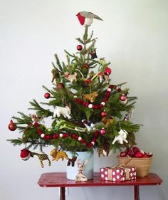 A table top tree decorated with animals is perfect for a child's room or playroom.