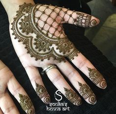 Loving this simple and unique partial hand design by Sonika's Henna Art.