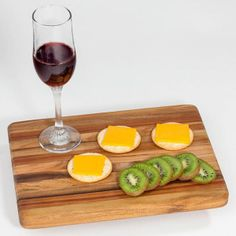 Teak Rectangle Cutting Board - Medium  $25.00  Classic teak beauty in a stunning edge-grain design.