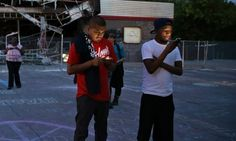 ferguson men cell phones Ferguson's citizen journalists revealed the value of an undeniable video