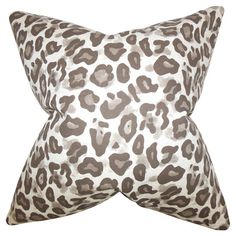 Bring an exotic touch to your sofa or favorite reading nook with this cotton pillow, featuring a leopard-print motif and down fill.     ...