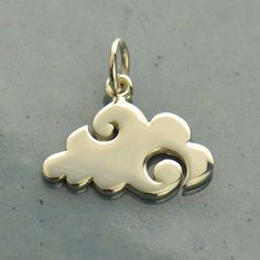 A personal favorite from my Etsy shop https://www.etsy.com/listing/280311140/sterling-silver-flat-plate-cloud-charm
