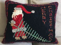 Christmas Santa pillow design by Cindy Gay. Hooked by Anne Anderson Penkal