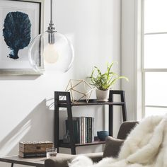 Overstock.com $107 Accentuate your refined sense of style with this inviting Uptown Globe pendant, featuring a clear glass shade. The styling of this effulgent, single-light fixture is complete with a glinting chrome finish.