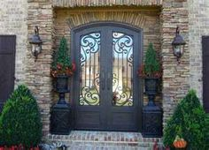 My house was MADE for double front doors and a stone inlay. Not sure about this stone or wrought iron, but this is the idea...