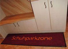 Fußmatte für die Schuhparkzone.