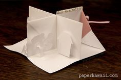 Origami Popup Book Video Tutorial,   Learn how to make an origami pop up book! This book opens up into 4 sections, it could be a mini house with 4 rooms, or a pretty landscape scene �...  #AllOrigamiPosts #Craft #Crafts #Cute #CuteOrigami #HowtodoOrigami #Instructions #Kawaii #MiniBook #MiniOrigamiBook #Miniature #MiniatureBook #Oragami #Orgami #OrigamiBook #OrigamiInstructions #OrigamiTutorial #Origamis #PaperCraft #PaperFolding #Papercraft #SecretBook #折り紙 #折纸 #摺紙