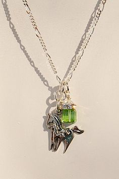 Pin it if you love it! Horse Charm Necklace Mother & Foal by Jeni B, Sterling Silver, Swarovski Crystals Peridot spring green  Joann Hayssen SRA  $44.00  -  20% of the purchase price will help feed the 50 horses at Rosemary Farm horse rescue and sanctuary!