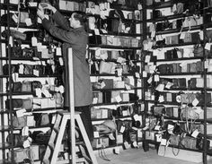 1940 A collection of abandoned gas masks at the London Transport's Lost Property Office.