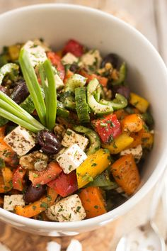 Colored peppers, feta cheese, kalamata olives, cucumbers. Seems like a good dressing.