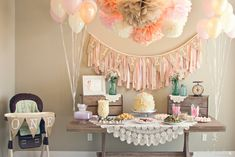 Shabby chic first birthday party - love the scrap fabric layered birthday banner! #firstbirthday #shabbychic #party