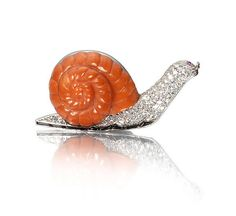 A coral and diamond snail brooch, by Cartier, circa 1930