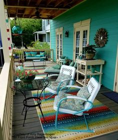 We adore the serenity on this back porch of our friend, Amy. So grateful she shared it with us to share with you. She has such a knack for color and delight. Love those vintage metal chairs, don't you? And I spy a porch swing.
