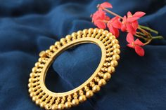 """Make a quiet statement with these traditional """"Gokhru"""" bangle kadas. These Gokhrus have emanating florets surrounding the main body.It comes with a screw fastening, so it can be worn with ease. Mounted with pure 24 Karat Gold Plating on pure 92.5 Sterling Silver."""